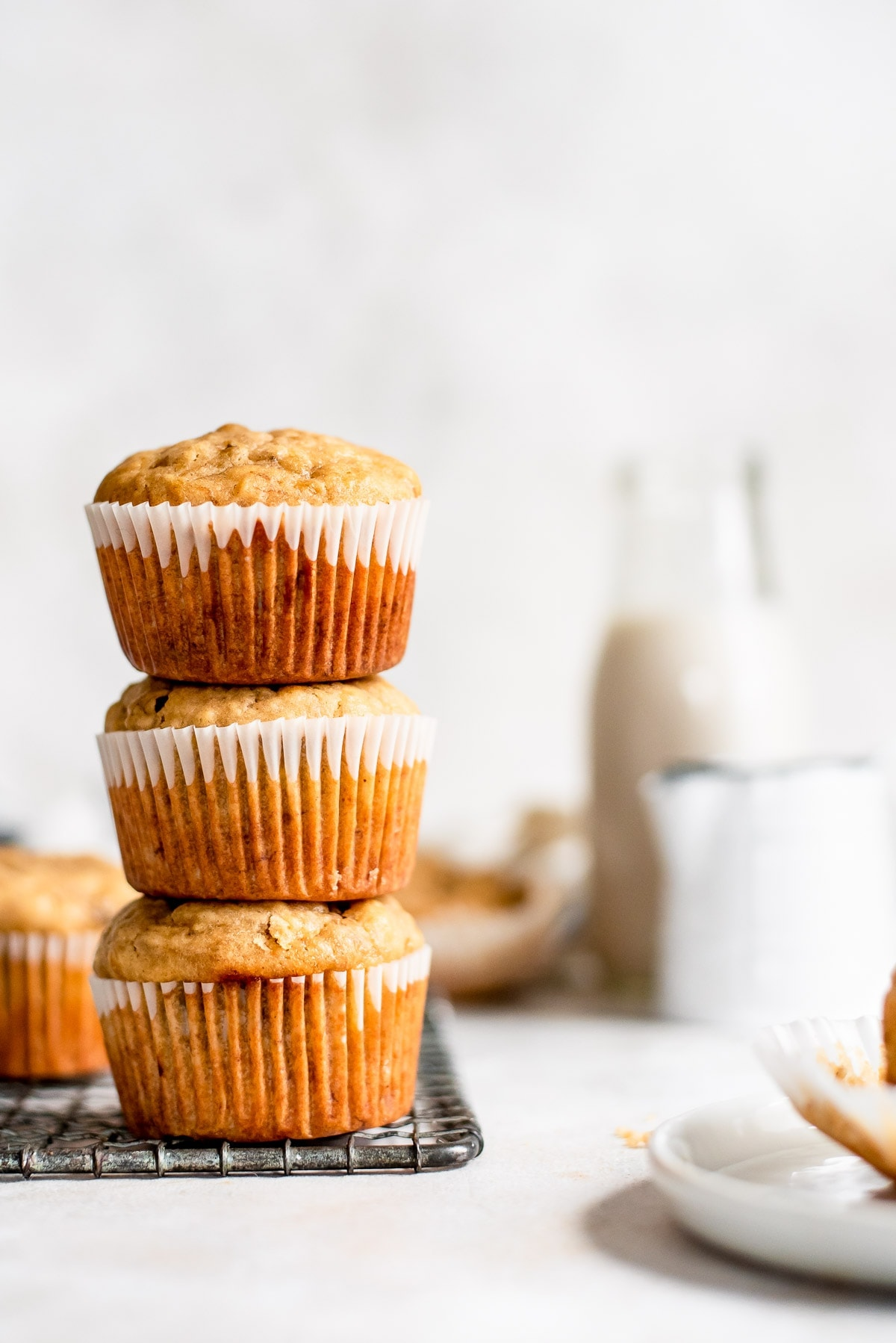 muffins stacked on one another on wire rack