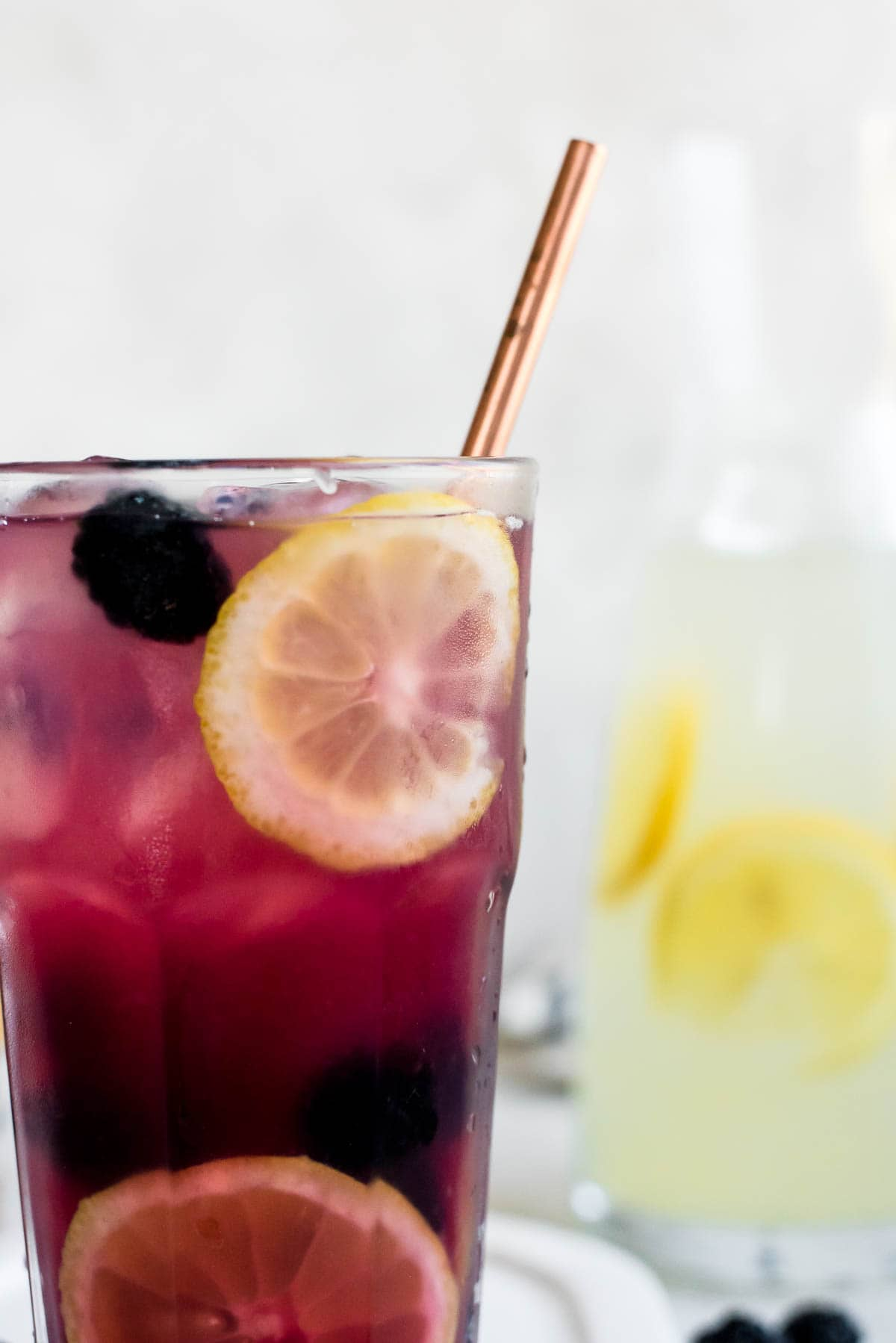 close up of glass of blackberry lemonade