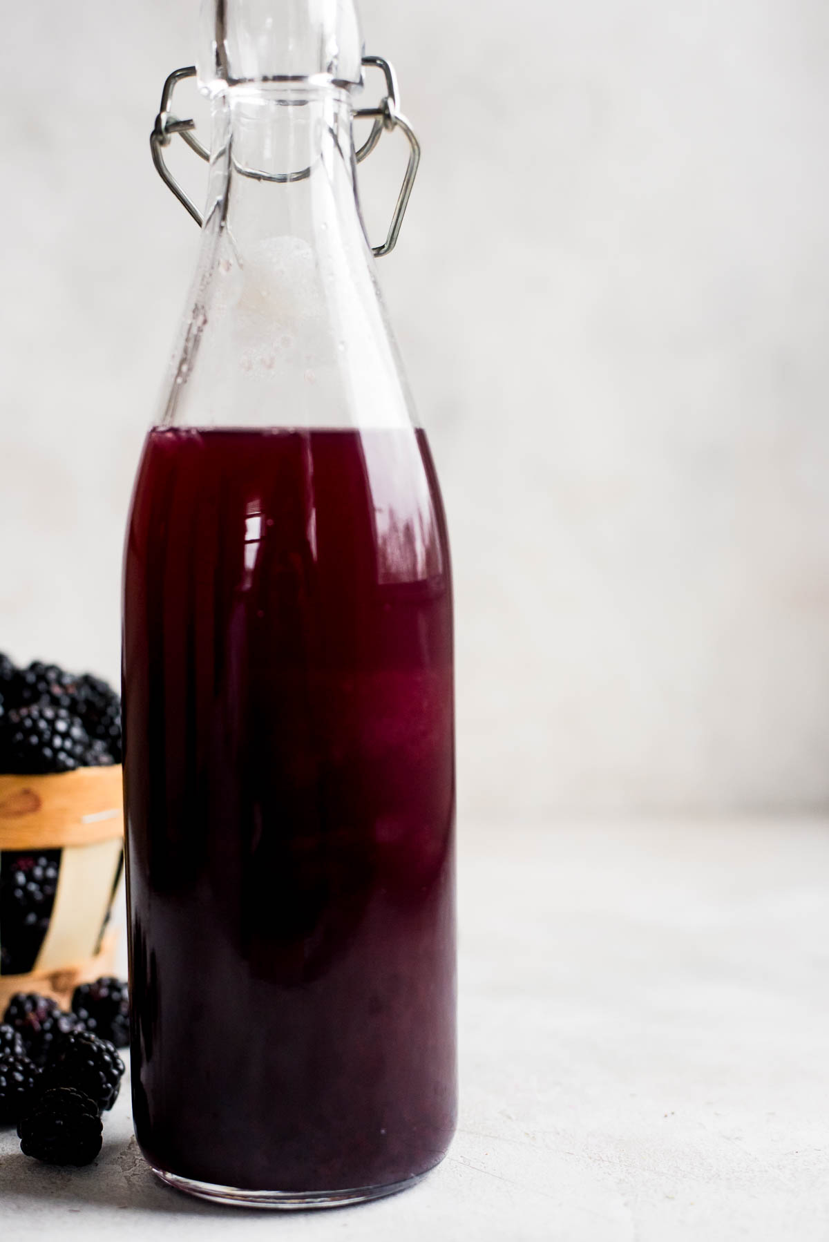 close up of blackberry syrup in bottle