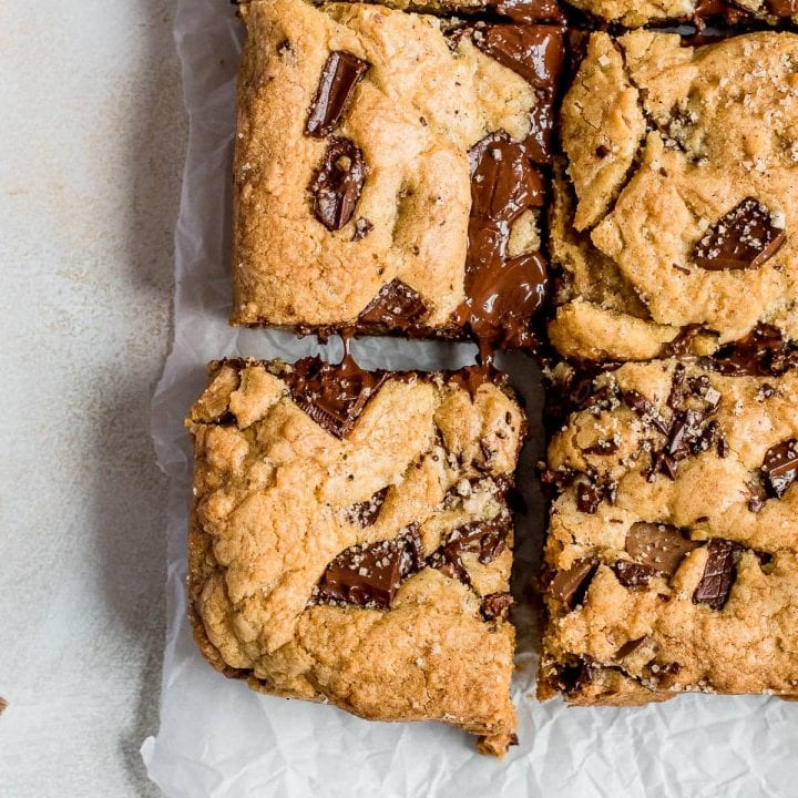 chocolate chip cookie squares on parchment paper close up