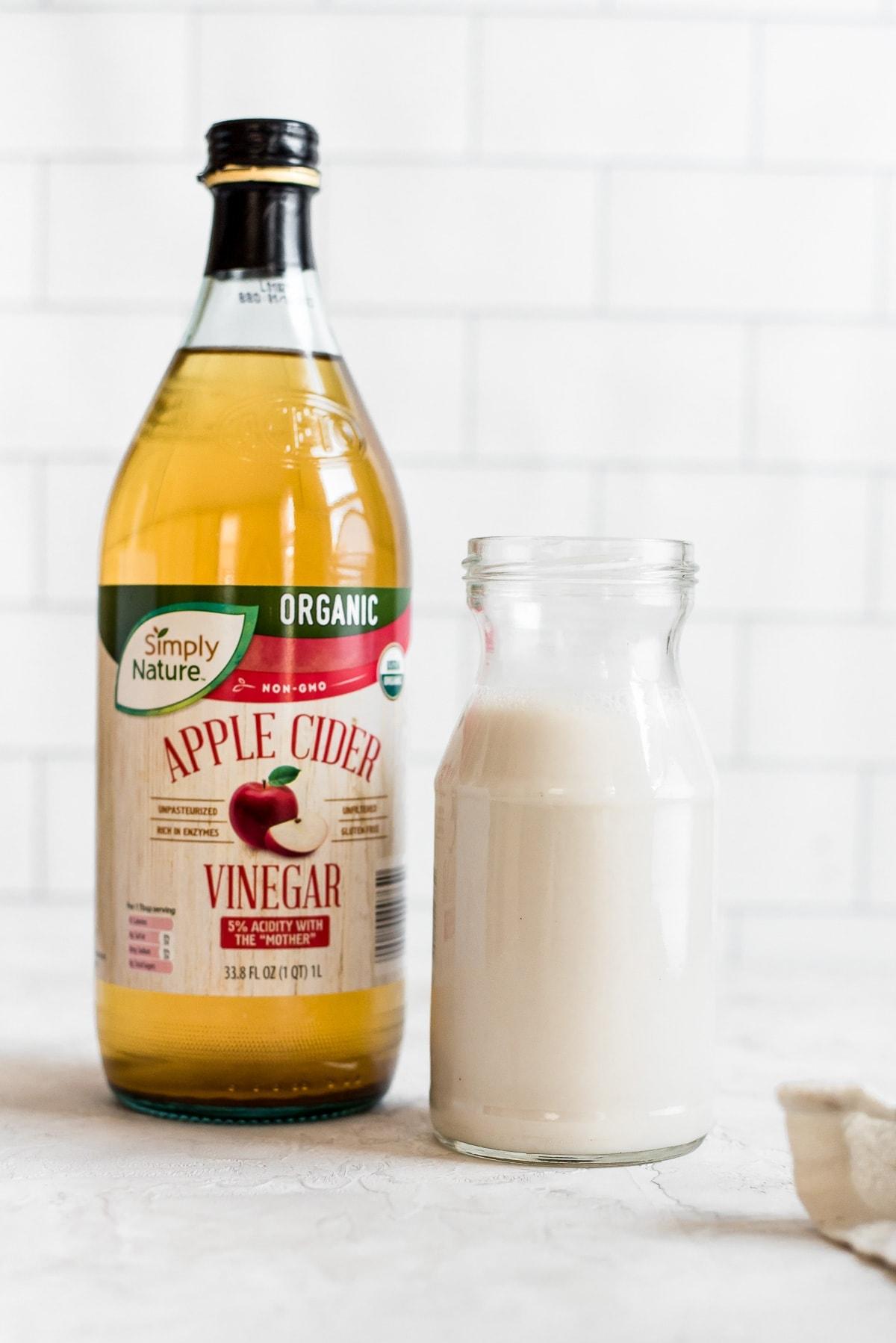 bottle of vinegar next to milk
