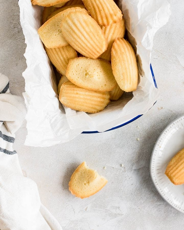 French madeleines in container and some on plate