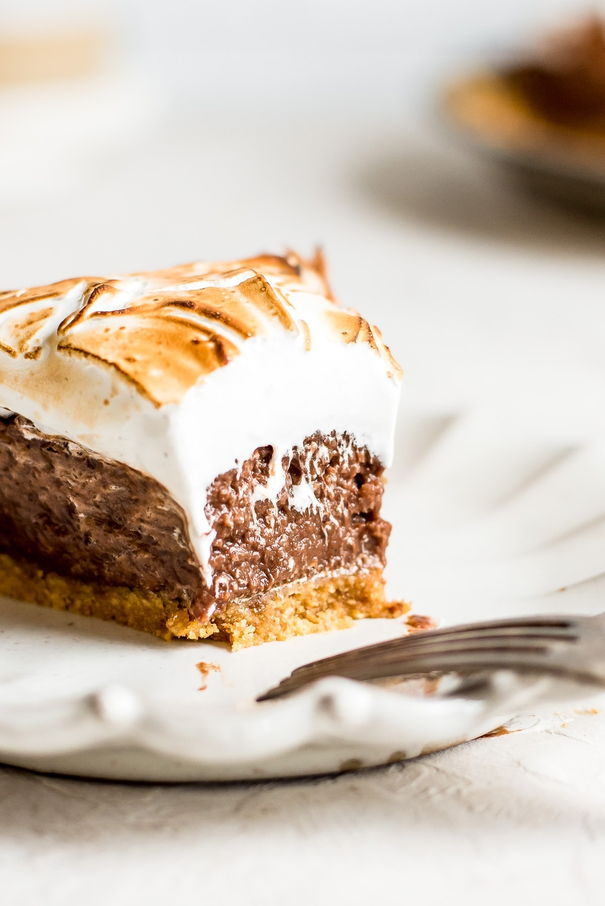 close up of smores pie with bite missing showing off filling