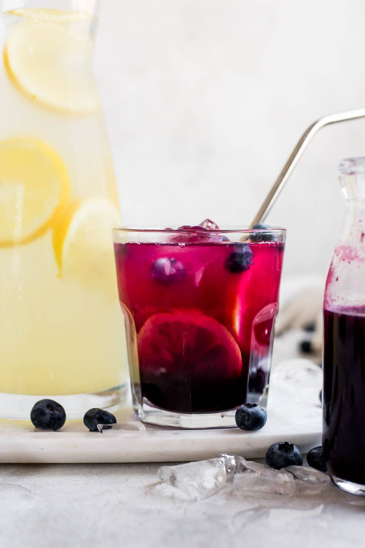 lemonade with blueberry syrup on tray