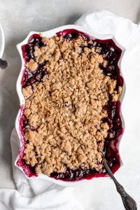 whole baked blueberry crisp in white pan
