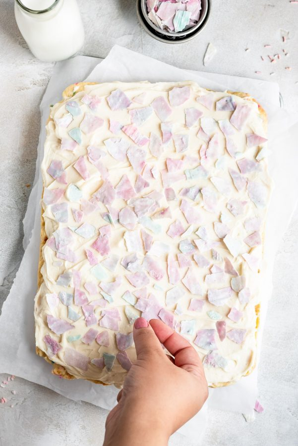 sprinkle chips being placed on frosting