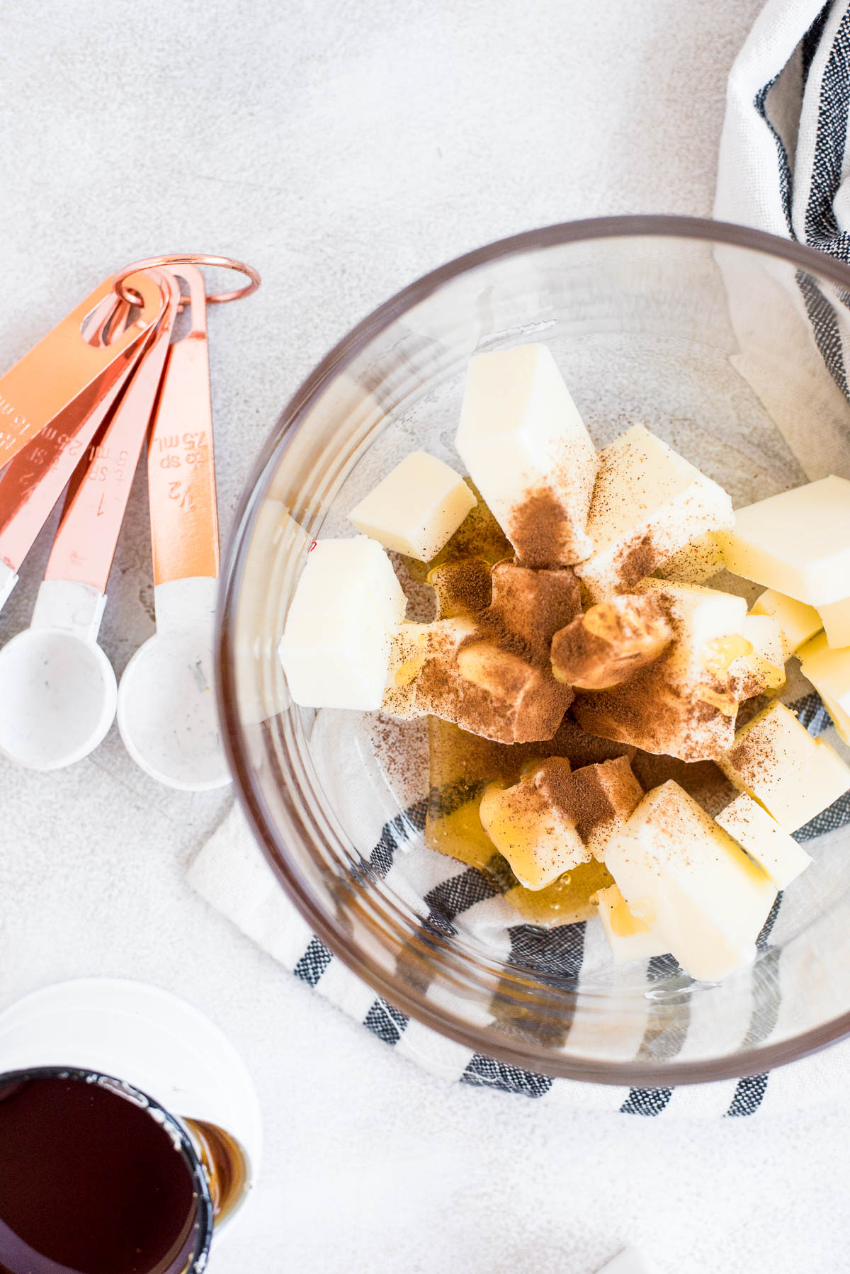 cinnamon over butter and honey in bowl