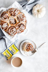 overhead of cinnamon rolls in pan and on plate