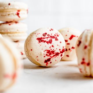 close up of macaron showing splatter of food coloring on shell
