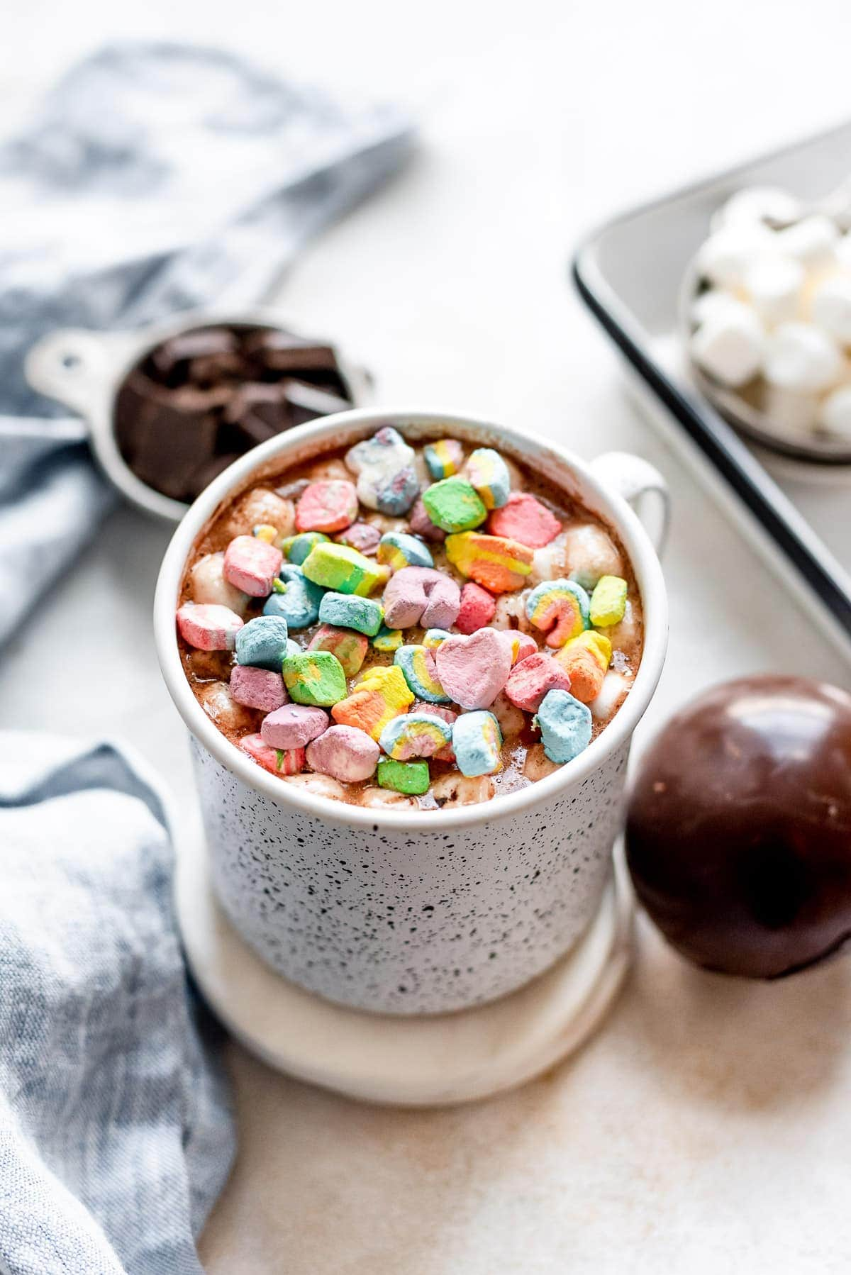 mug of hot chocolate with lucky charm marshmallows