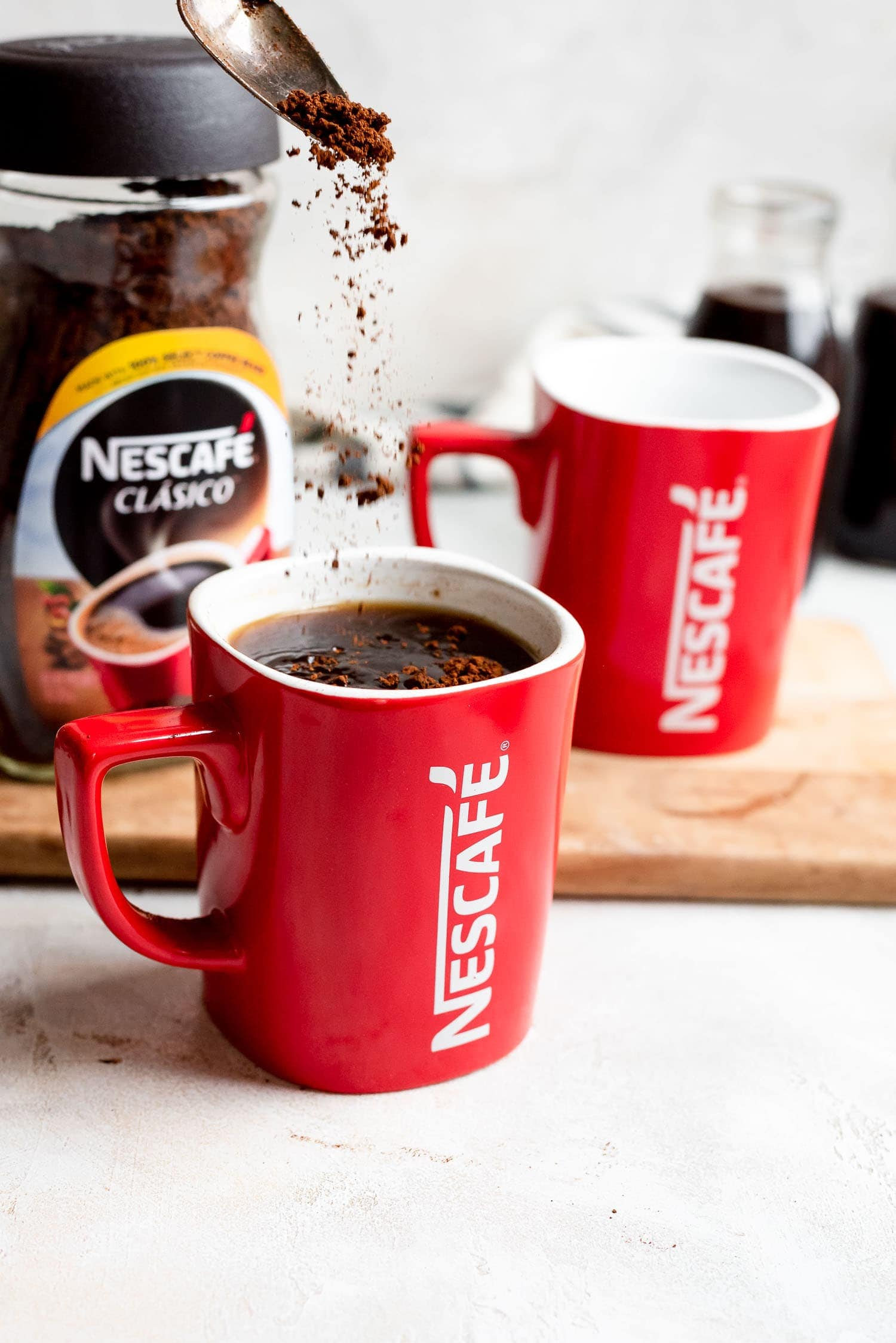 instant coffee being poured into a mug