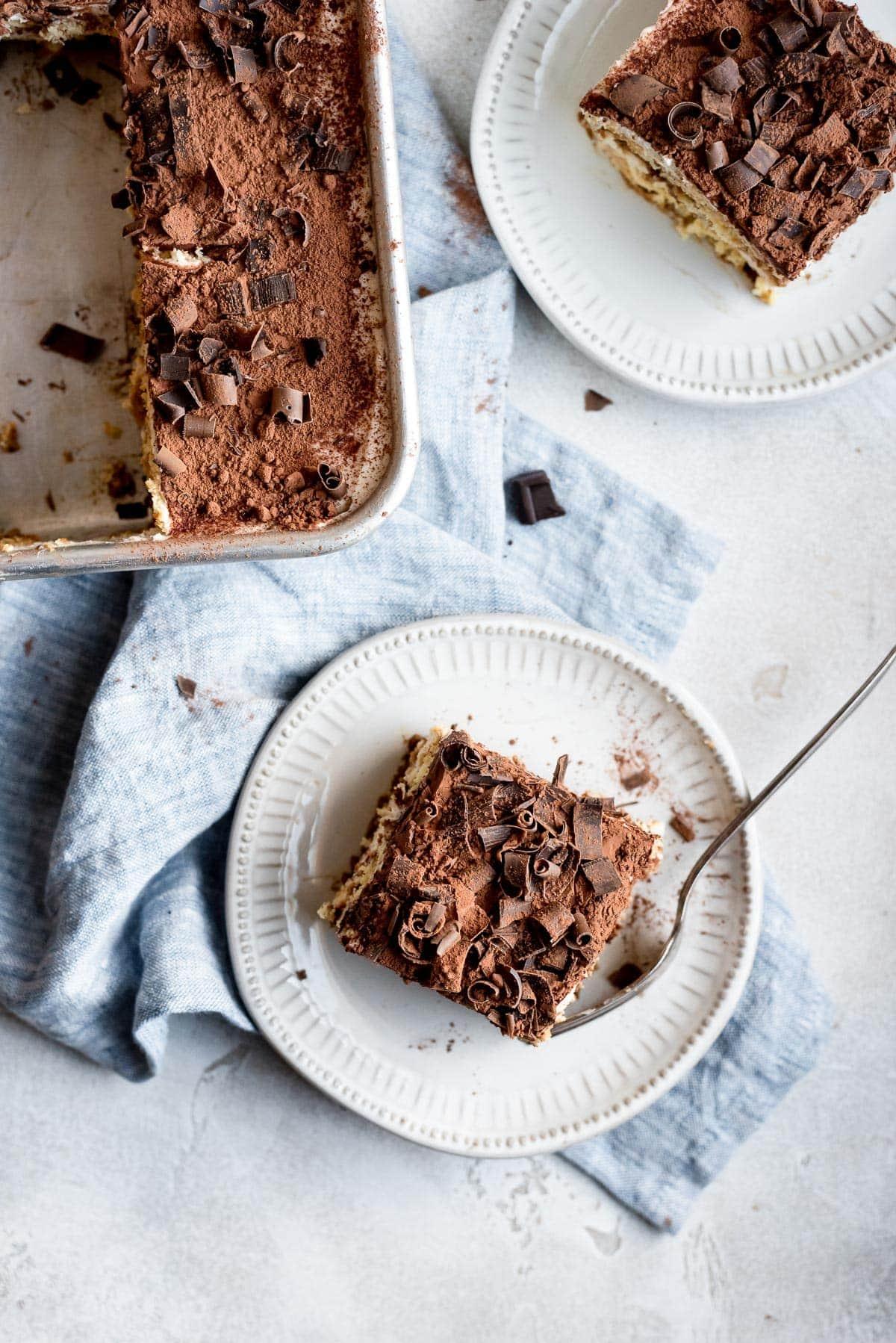 pverheat pan and plate both filled with the tiramisu cake