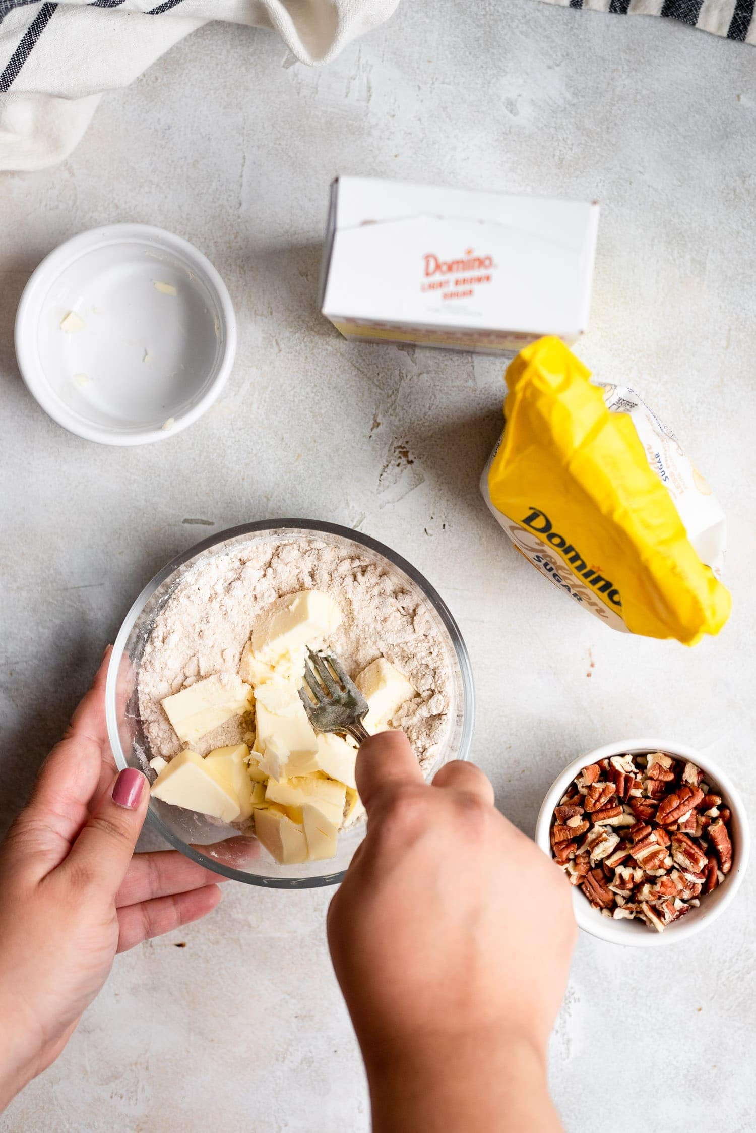 adding butter into flour to make streusel