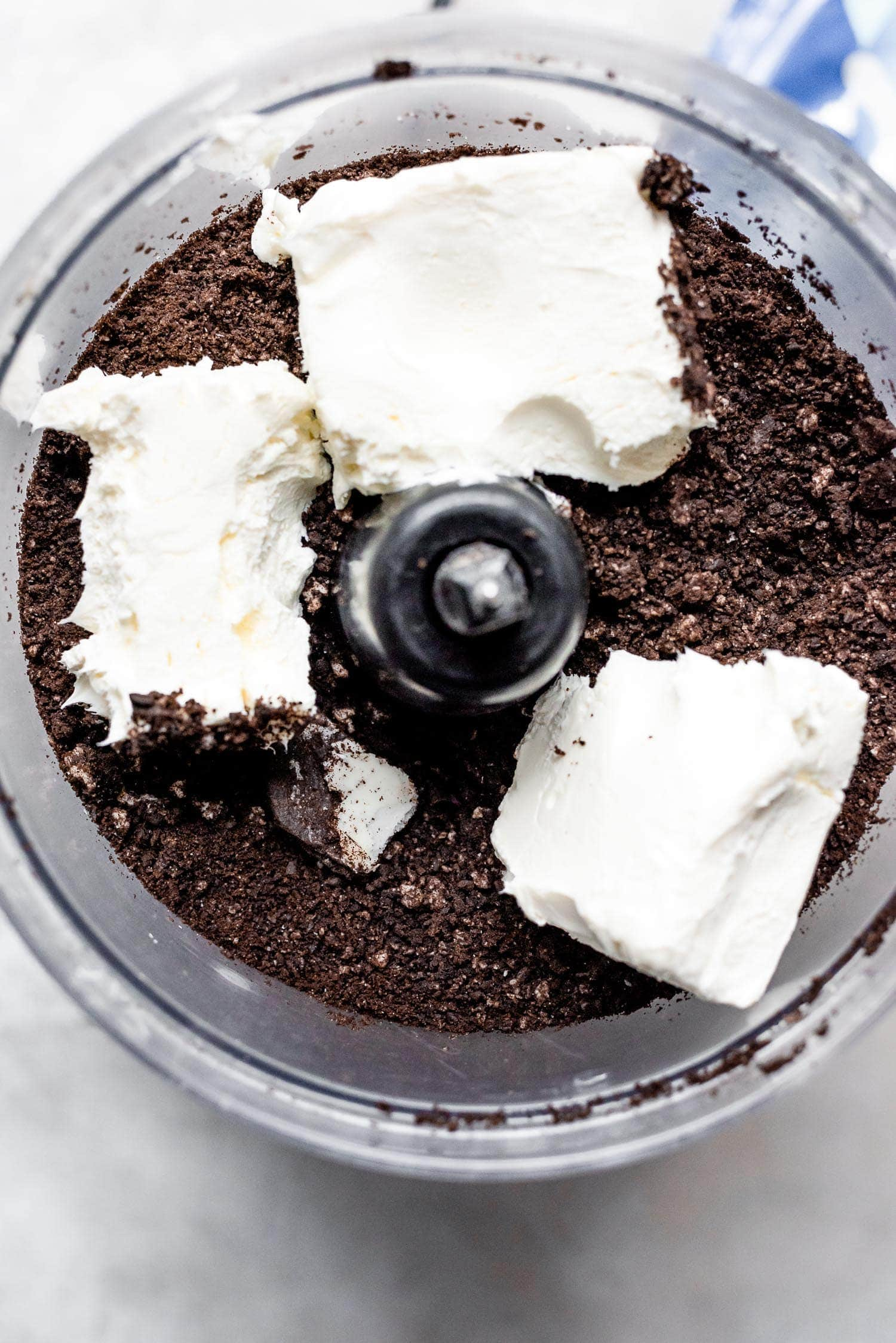 crushed oreos and cream cheese in food processor