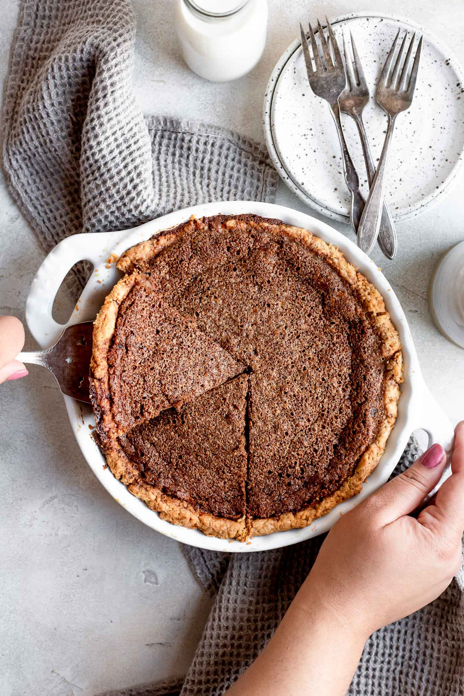 pie with slices being removed from pan