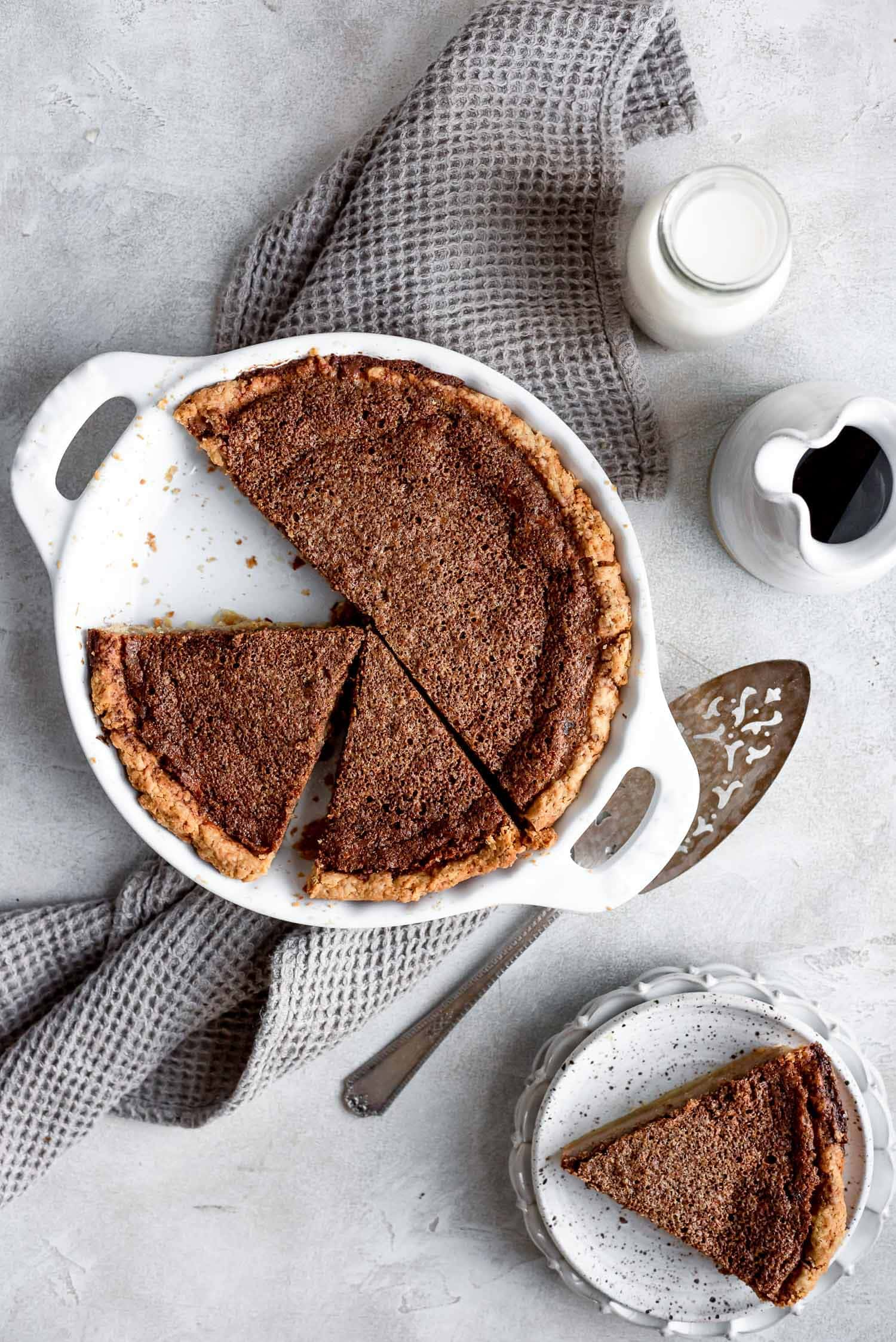 brown suugar chess pie fresh from oven with slices being cut
