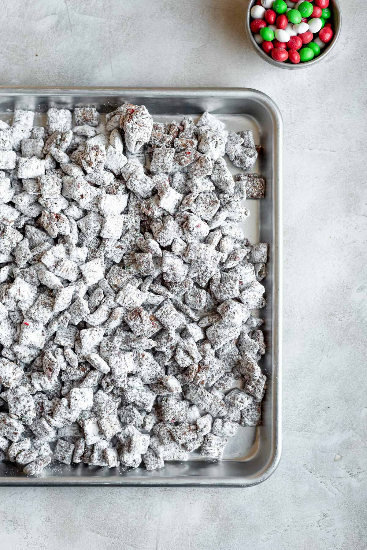 christmas puppy chow on baking sheet