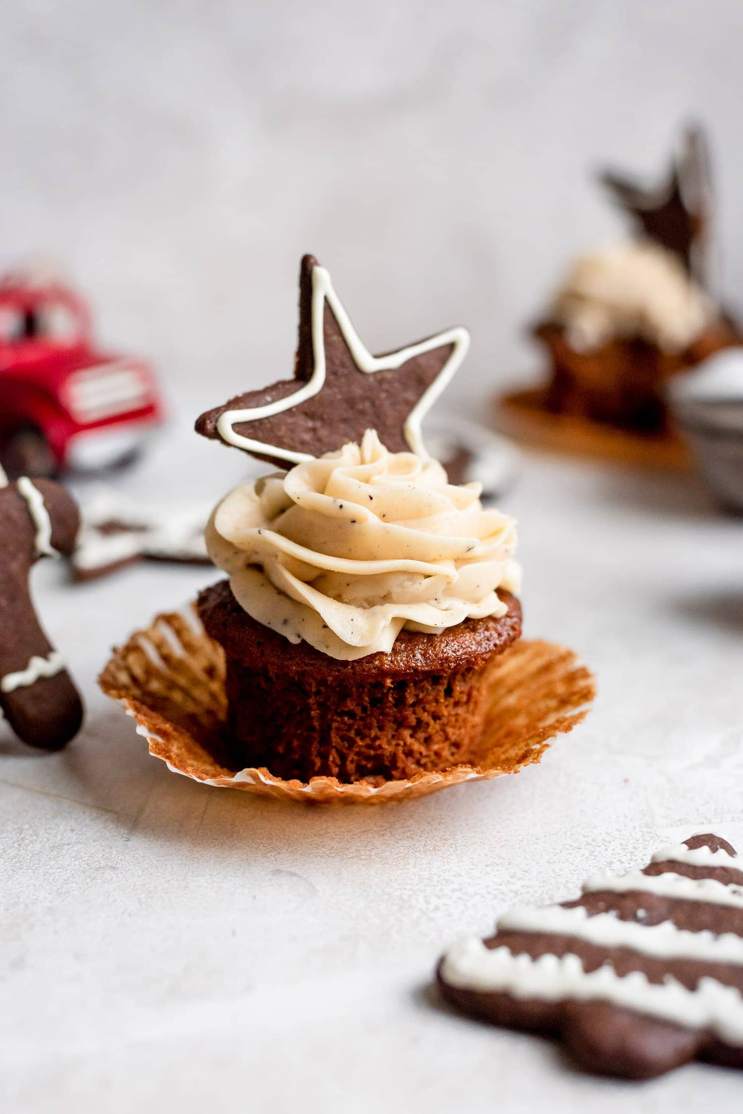 cupcake with wrapped peeled away and topped with gingerbread cookie
