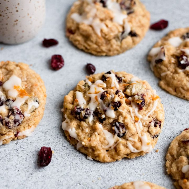 scattered cookies on table with cranberries