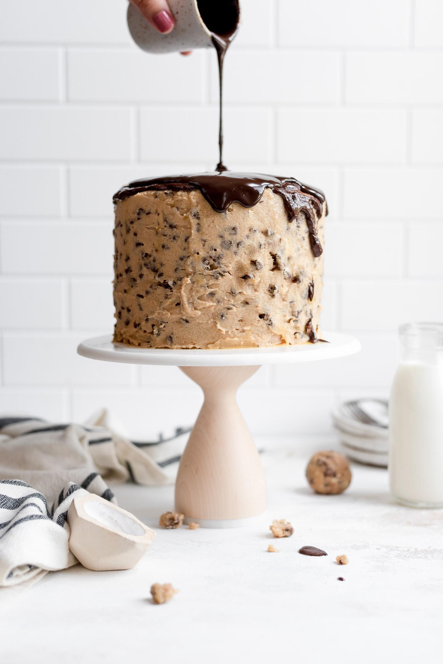 ganache being poured on cake