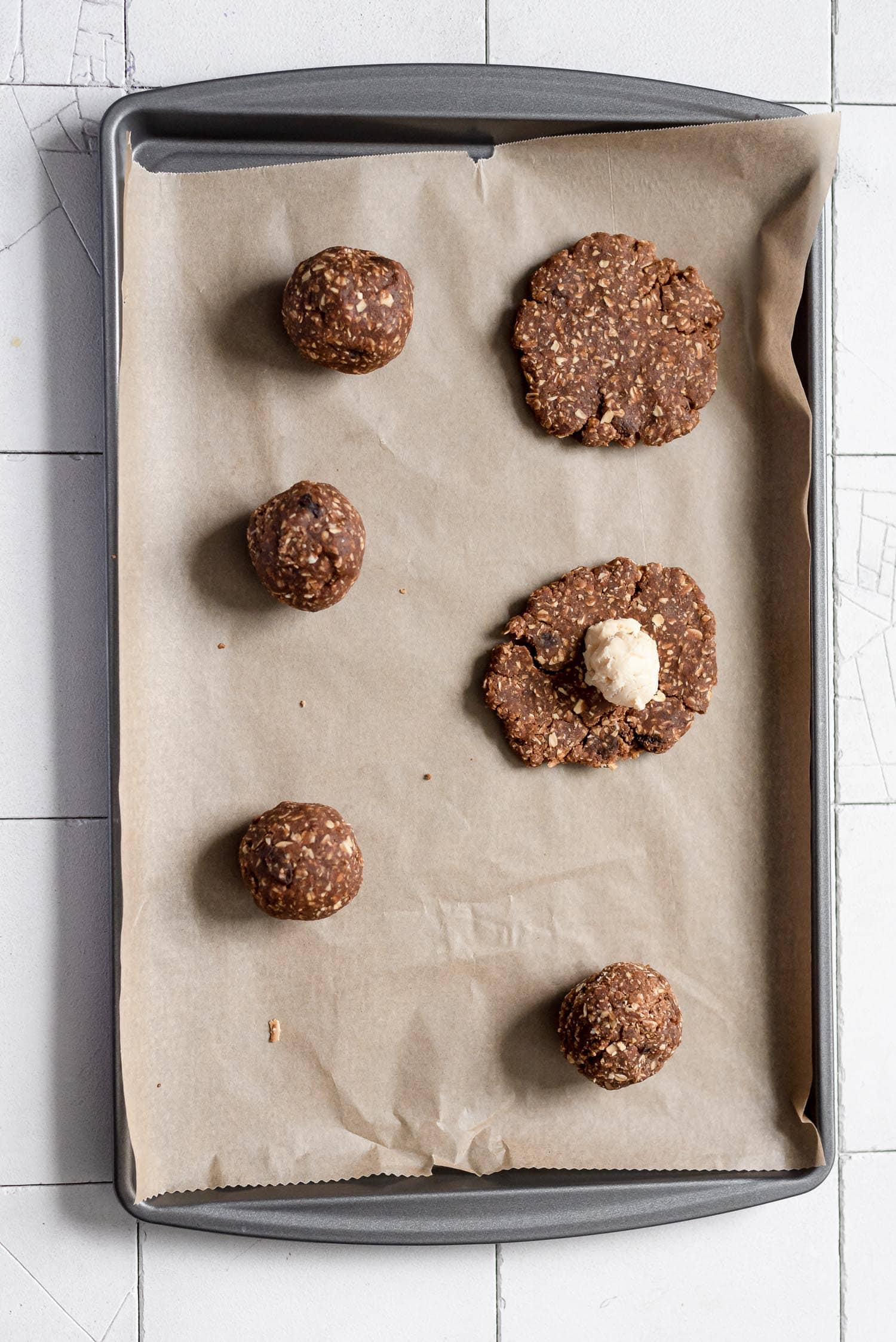 cookies being roled and places on baking sheet